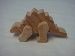 "DINOSAUR STEGOSAURUS 1-1/8"" TALL AND 2-1/4"" LONG"
